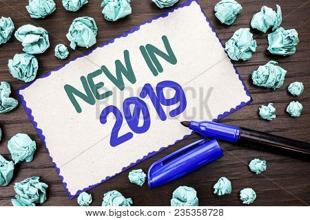 Writing note showing  New In 2019. Business photo showcasing Fresh Era Latest Year Period Season Annual Coming Modern written Cardboard Piece the wooden background Marker next to it. poster