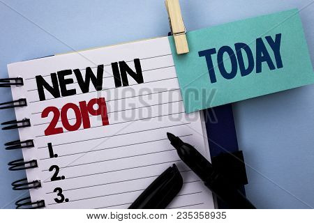 Conceptual hand writing showing New In 2019. Business photo text Fresh Era Latest Year Period Season Annual Coming Modern written Notebook Book plain background Today Marker next to it poster