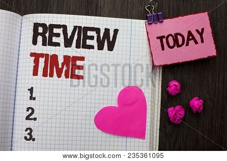 Conceptual hand writing showing Review Time. Business photo showcasing Evaluating Survey Reviewing Analysis Checkup Inspection Revision written Notebook Book wooden background Today Heart. poster