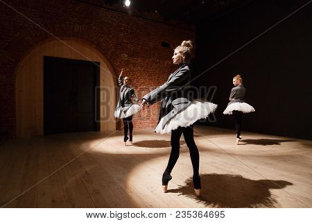 The Ballet Concept. Young Ballerina Girls. Women At The Rehearsal In A White Tutu And A Grey Jacket.
