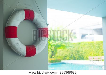 Life Ring Hanging At The Swimming Pool As Rescue Equipment