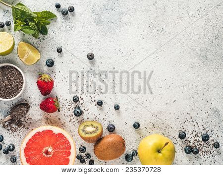 Ingredients For Chia Water And Infused Detox Drink On Gray Concrete Background. Copy Space. Above Vi