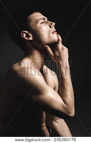 Side View Half Length Pensive Man Stripped To Waist Holding Chin By Hand. Muse Concept