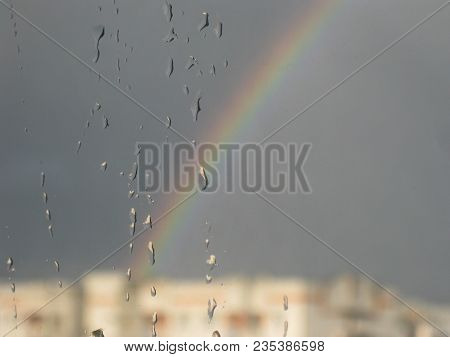 Rainbow On Glass Background. Raindrops On Glass With Rainbow. Rain Drops Background Or Texture, Wate