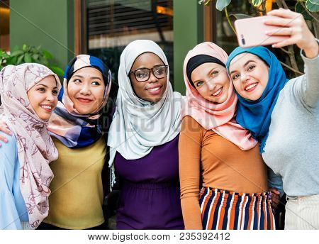 Muslim woman catching up together after work