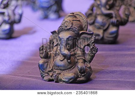 Small Figurines Of Buddha, Ganesha, Frog In The Market Of Bazaars In India. Souvenir Gift India.