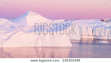 Iceberg from glacier in arctic nature landscape on Greenland. Aerial photo from drone of icebergs in Ilulissat icefjord. Affected by climate change and global warming.