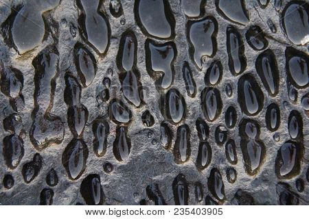 Old Background Stone Wall, Texture. Black Or Gray Stone For Background. Beautiful Stone Structure Or