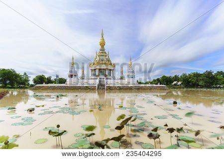 Magnificent Wat Thung Setthi (The Great Jewel Chedi of the three worlds) in beautiful day and reflection , Khon Kaen , Thailand poster