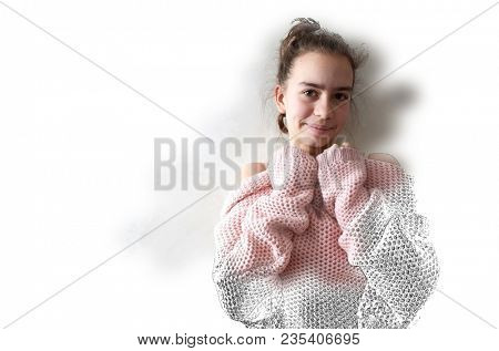 Beautiful portrait of thirteen year old girl in pink knitted loose sweater shy smiling and looking at camera. Drawing and brushed In photo combination with copy space on white background