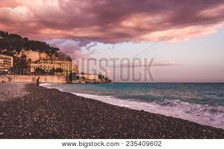 Violet Colored Sunset On Beach Of Nice