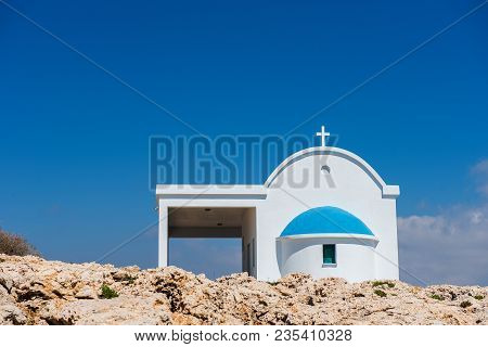 Small Greek White Chapel With A Blue Roof