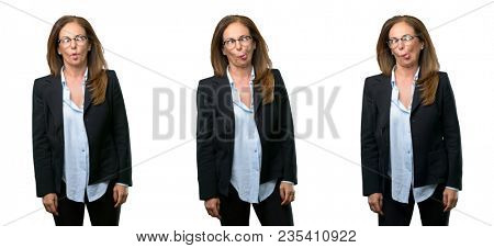 Middle age business woman making funny face fooling over white background