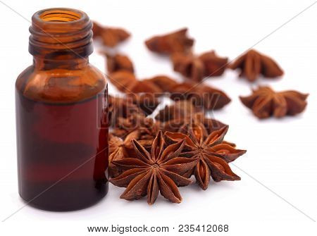 Aromatic Star Anise With Essential Oil In A Bottle Over White Background