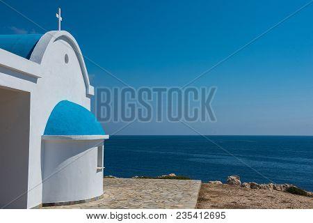 Whitewashed Chapel Near The Sea