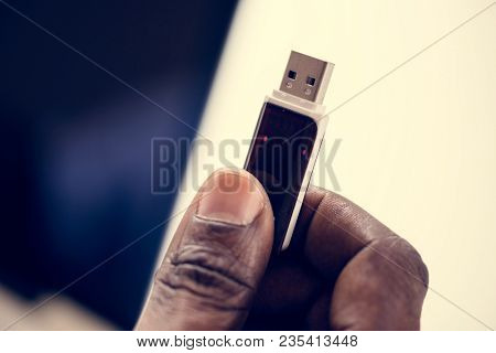 Hand holding Universal Serial Bus portable data backup
