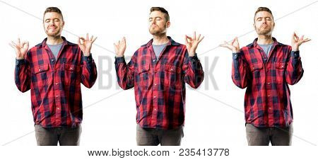 Young man doing ok sign gesture with both hands expressing meditation and relaxation isolated over white background, collage composition