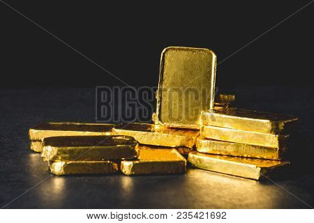 Stack Of Pure Gold Bars On Black Background