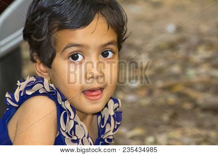 Close Up Of Little Indian Girl With Her Mouth Open, Empress Garden At Pune