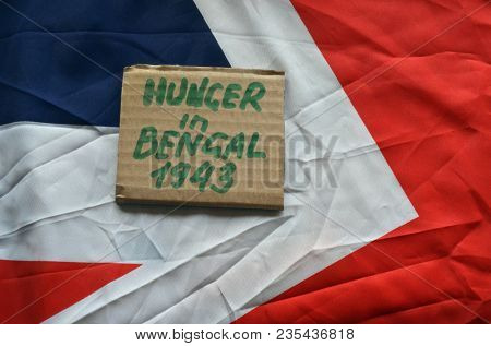 British history.History of genocide. The famine in in Bengal 1943. Concept.British Flag background. April 9, 2018 in Kiev,Ukraine