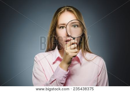 Girl See Through Magnifying Glass, Kid Eye Looking With Magnifier Lens Over Gray.