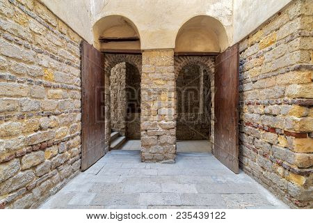 Exterior Brick Stone Passage With Two Adjacent Vaulted Opened Wooden Grunge Doors, Old Cairo, Egypt