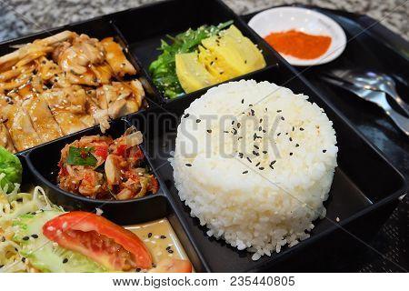 Traditional Japan Cuisine, Bento Box Or Multi-layered Box With Teriyaki Chicken Rice, Salad, Tamagoy