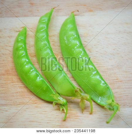 Vegetable, Fresh Green Peas Pods On Cutting Board, High In Vitamin K, B, C And A.