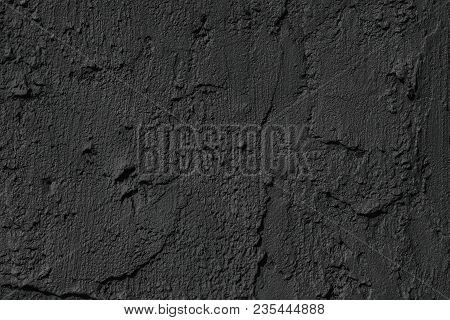 Black Cement Plaster Smears Texture. Dark Concrete Wall Background. Matte Coating