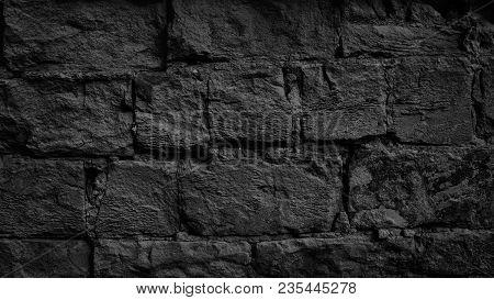 Black Old Brick Wall. Dark Brickwork Texture. Gloomy Grunge Background
