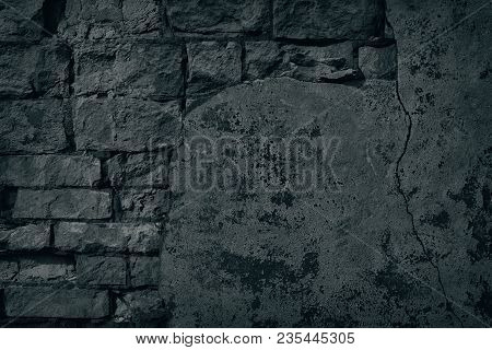 Black Old Brick Wall With Cracked Fallen Off Plaster And Peeling Paint. Crumbled Old Shabby Brickwor