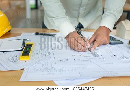 Construction Engineering. Architect Drawing Blueprints And Engineering Tools On Workplace