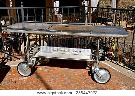 An Old Stretcher Or Gurney Used For Transporting Medical Patients Is Used For Outside Activities And
