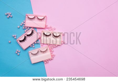 Eyelashes With Beat In The Box On Pink And Blue Backgorund. Copy Space.beauty And Fashion Concept.