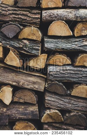 Firewood In Woodpile, Prepared For Winter. Pile Of Firewood. The Firewood Background. A Stack Of Nea