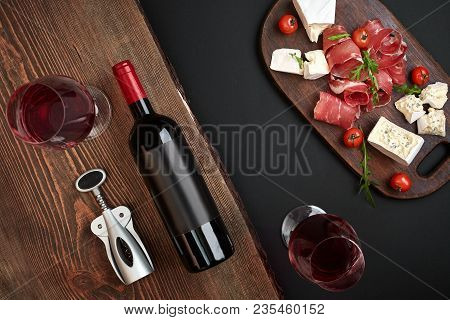 Above Overhead View Flat Lay Still Life Of Assortment Various Cheese And Delicatessen And A Bottle O