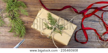 Christmas Fir Tree And Gift Box On Rustic Wooden Table