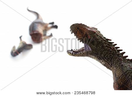 Carcharodontosaurus And A Dinosaur Bloody Body On White