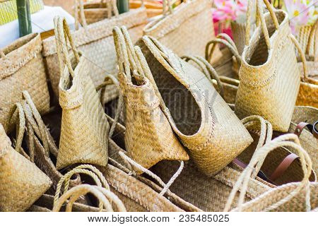 Product Weaving A Wicker Basket By Handmade, Product Work In The Family Industry. Sale In A Market O