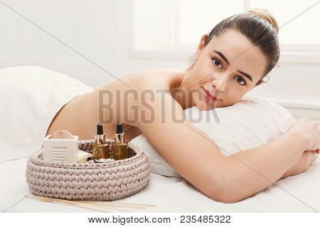 Relaxed Woman After Classical Body Therapy With Organic Oils At Spa. Relaxation And Wellness Backgro
