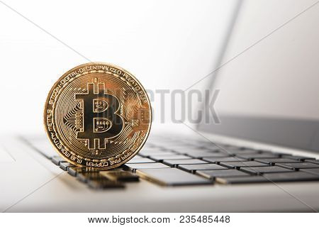 Golden Bitcoin - New Virtual Money On Notebook. A Visual Representation Of Digital Cryptocurrencies.