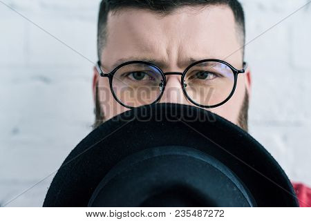 Obscured View Of Stylish Man In Eyeglasses With Hat