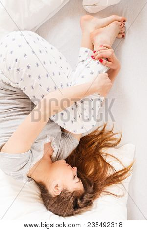 Exhaustion Relax Dreaming Sleep Concept. Tired Girl Sleeping. Young Lady Resting In Fetal Position R