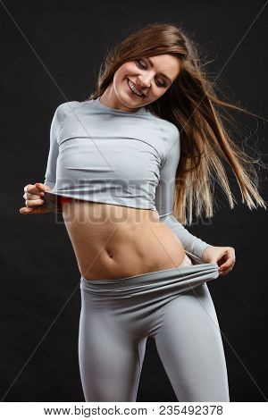 Fit Fitness Slim Woman Wearing Hot Gray Sports Thermolinen Underwear, Studio Shot On Black. Long Sle