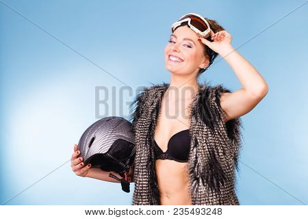 Winter Sport Activity Concept. Atractive Smiling Woman Wearing Black Bra, Ski Goggles And Furry Wais