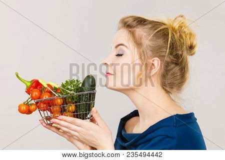 Buying Good Food, Vegetarian Products. Attractive Woman Holding Shopping Basket With Green Red Veget