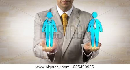 Unrecognizable Recruiter Balancing Out One Male Worker On A Par With One Female In The Open Palms Of