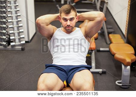 Sport, Fitness, Bodybuilding, Lifestyle And People Concept - Young Man Doing Sit-up Abdominal Exerci