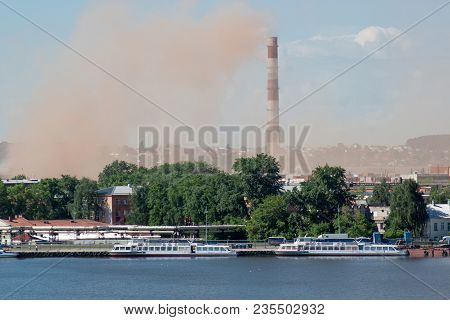 Metallurgical Plant Near A Beautiful Lake. Emission Of Nitrogen Oxide Into The Atmosphere. Pollution