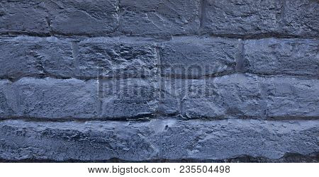 The Brick Wall Painted In Blue. Background Of Old Vintage Blue Brick Wall. Blue Brick Wall .street L